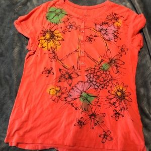 Orange Top with a Peace Sign Design